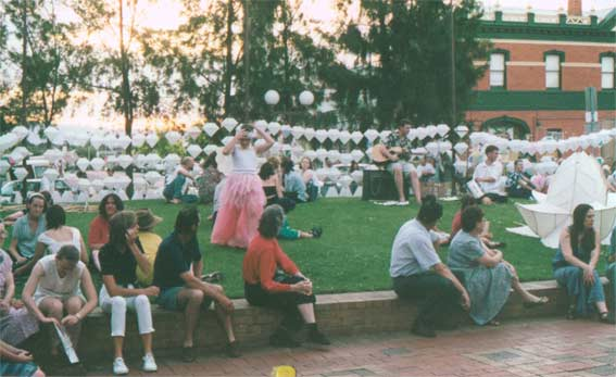 Lanterns arrayed and crowd waiting for the Lantern Parade in the Stawell Mall, 11 December 1998