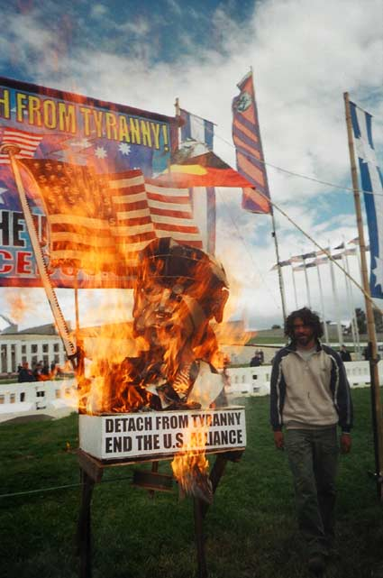 Bush/Howard effigy burns outside parliament House during visit by US President Bush 23 October 2003 lit Darren Blomfield from the Aboriginal Tent Embassy