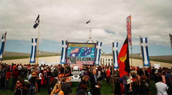 Peacebus.com bAnneer array outside Parliament House Canberra for the visit of US President GW Bush, 23 October 2003