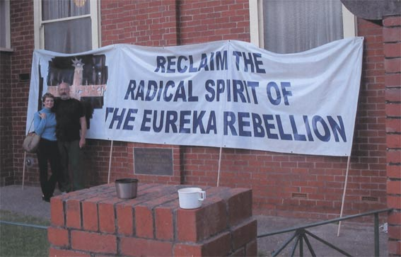 The banner displayed by Dr Joe Toscano and the Anarchist Media Institute at Eureka Hall, 3 December 2003