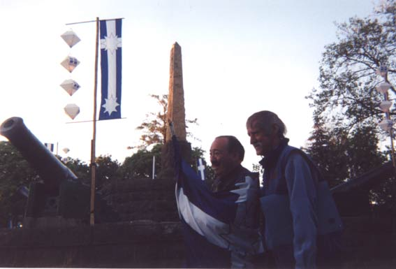 Al Grassby, Eureka historian and former Minister for Immigration in Whiltam government1972-75, and Frank Williams, Chair of the Eureka Memorial and Park Trust, face the dawn wrapped in Eureka flag, Sunday 7 December 2003