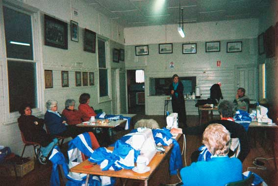 Story teller Anne E. Stewart does cultural barter at the Eureka150 Women's Sewing Circle in the Eureka Memorial Hall, 8 November 2004