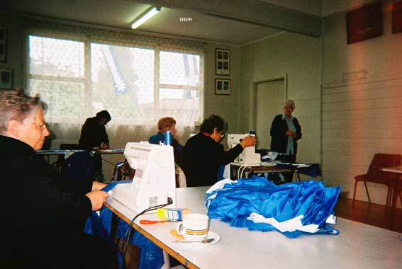 Shirley Jones, right supervises the Eureka150 Women's Sewing Circlein the Eureka Memorial Hall, 8 November 2004. That's Bev Bird in the foreground left.